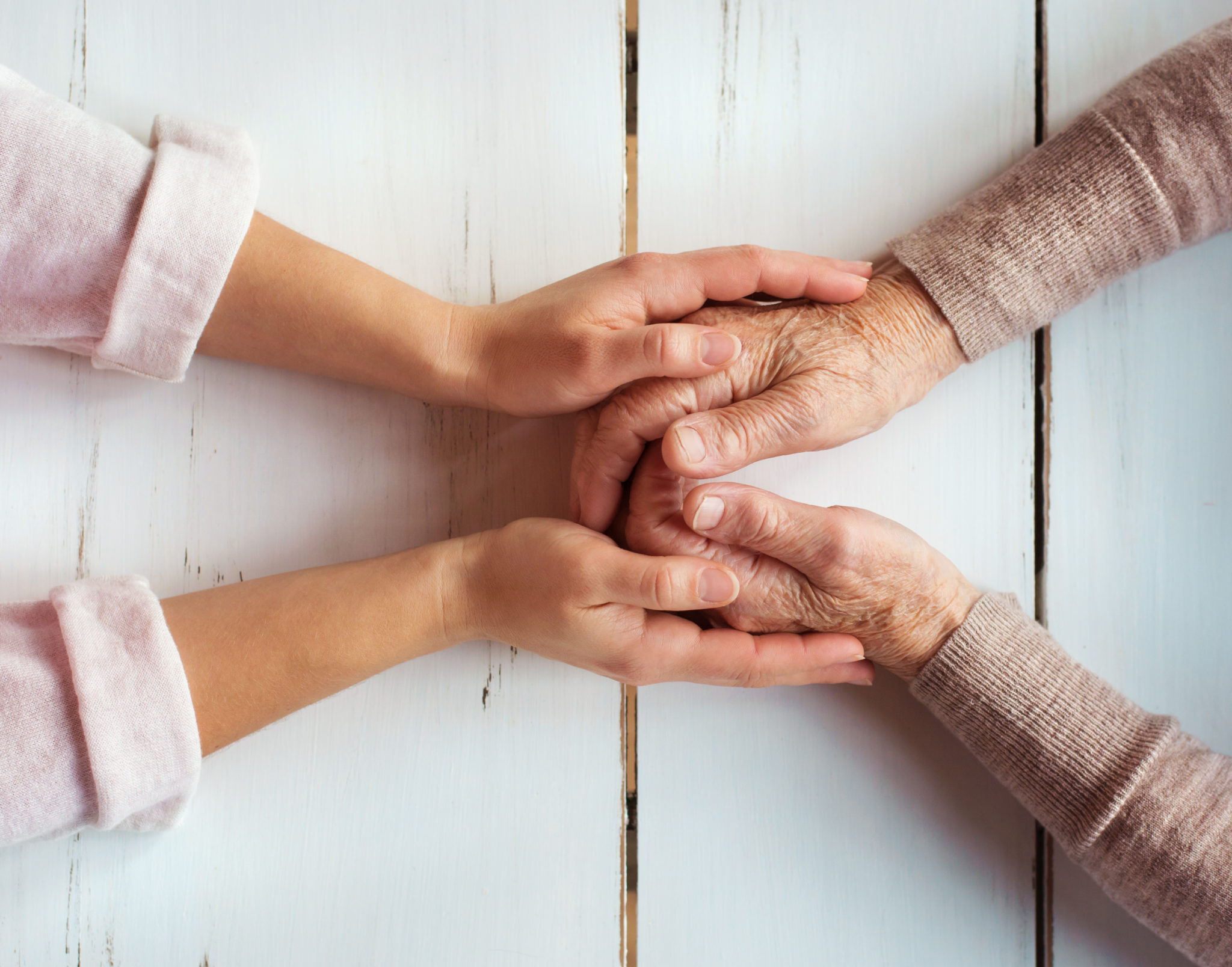 Grandmother and her granddaughter holding hands.
