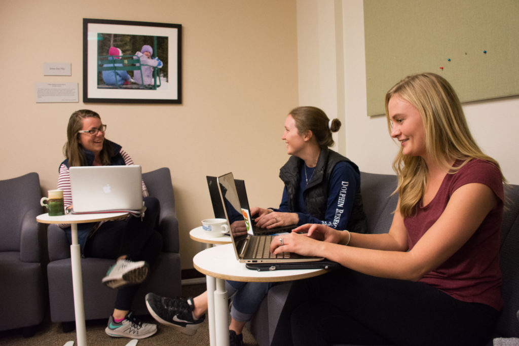 Students work and mingle in the renovated Wanda Mayberry Student Lounge