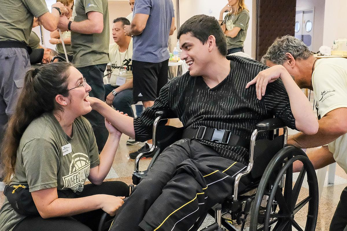 Danielle helping gentleman in wheelchair