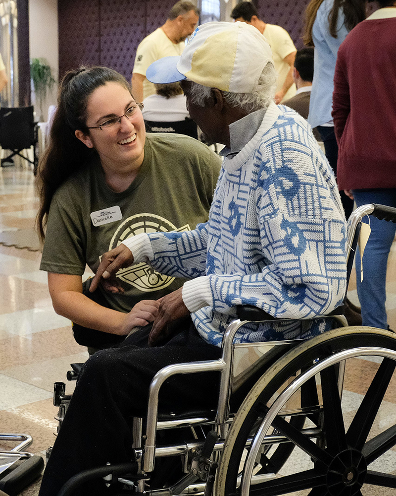 Danielle talking with adult in wheelchair