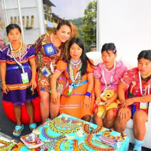 Diana Luna with people in colorful native dress
