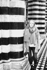 Black and white picture of Gretchen Shephard with patterned stone