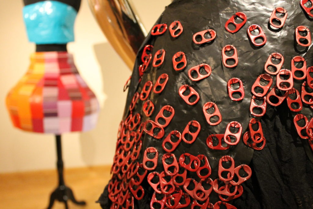 close up of pop tab dress with paint chip dress