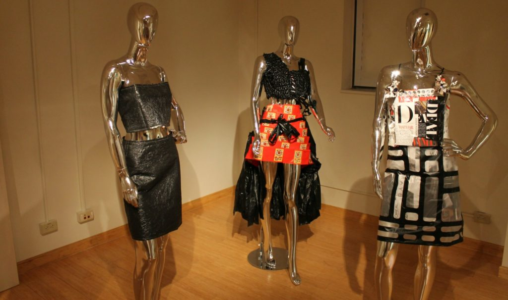 Three dresses made of recycled materials