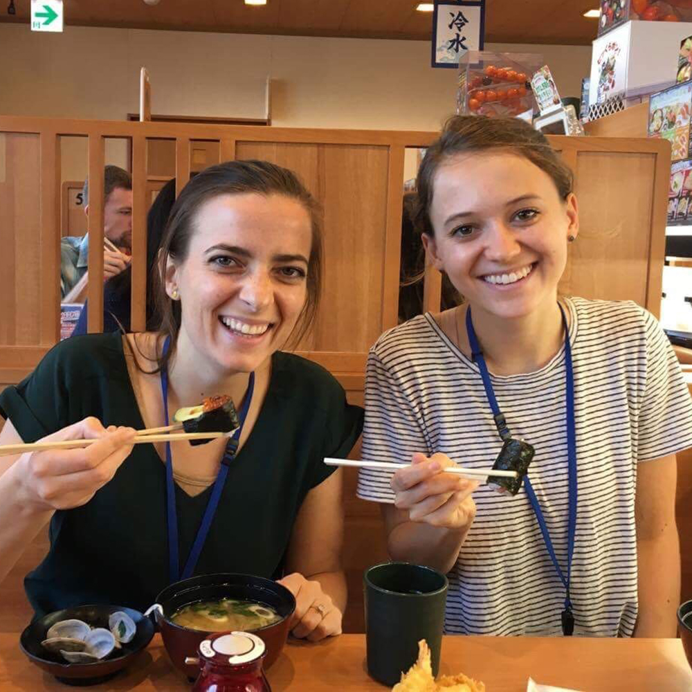 Students eating with chopsticks