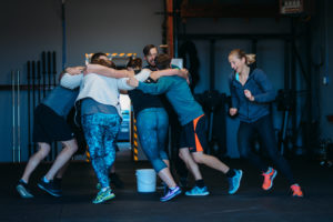 Gym members running in a linked chain