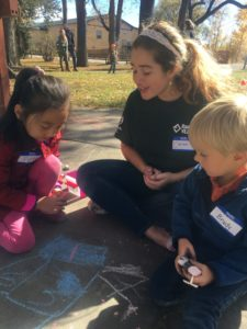 Students interact with kids during fall picnic for RKV