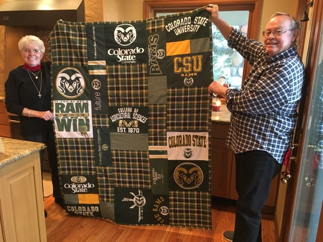 John and Judy Sitzman holding up quilt