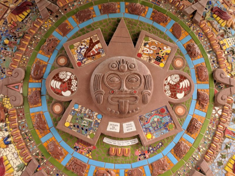 Aztec calendar mosaic in bright colors