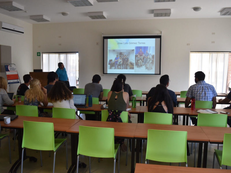 Students watch a presentation introducing them to the situation in Todos Santos.