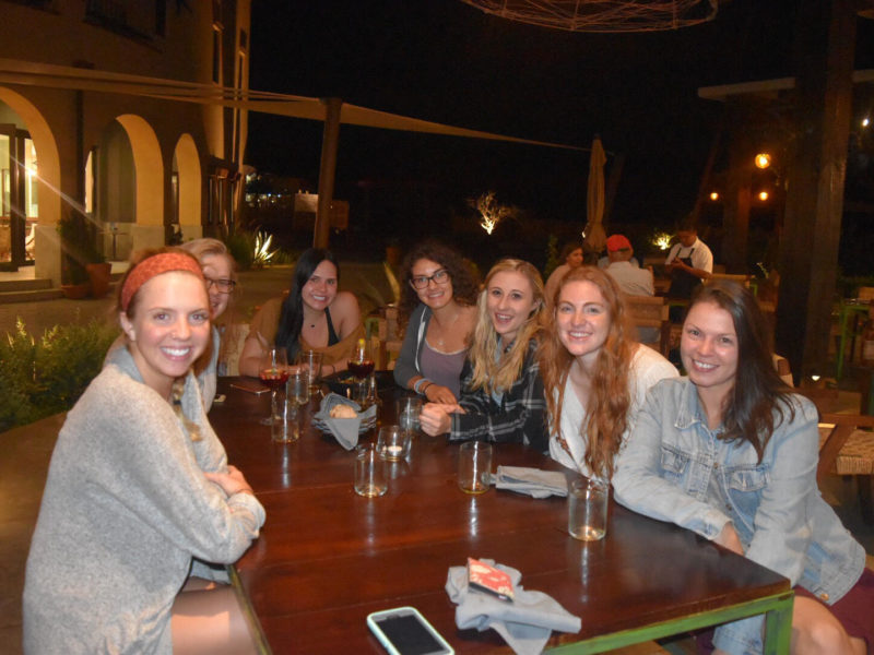 The service learning group enjoys their evening in a restaurant.