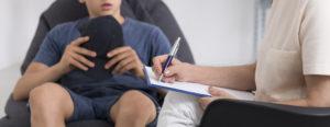 Therapist talking to child