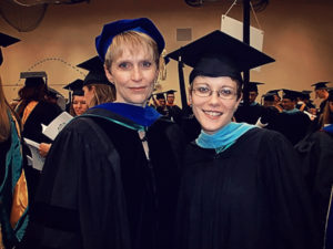 Jackie Peila-Shuster and Julie Hill at graduation