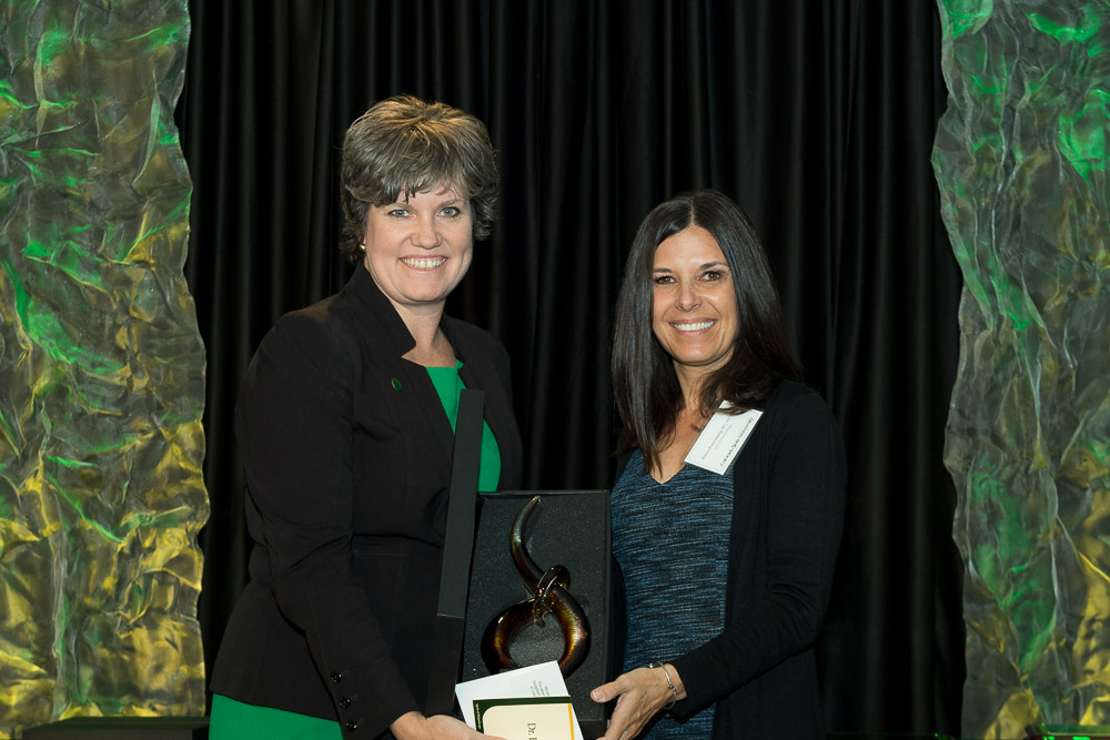 Tobin and Rattenborg smile as Rattenborg receives her award at the Celebrate! CSU event.