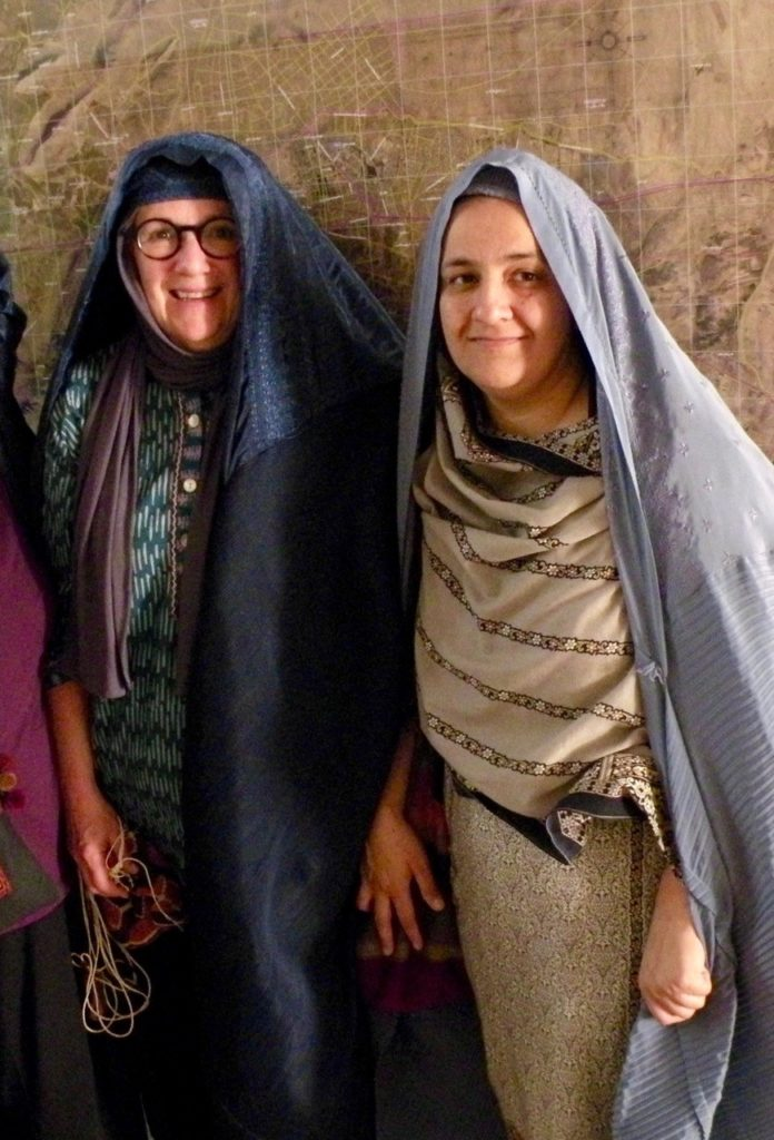 Mary Littrell and Rangina Hamidi in burqas