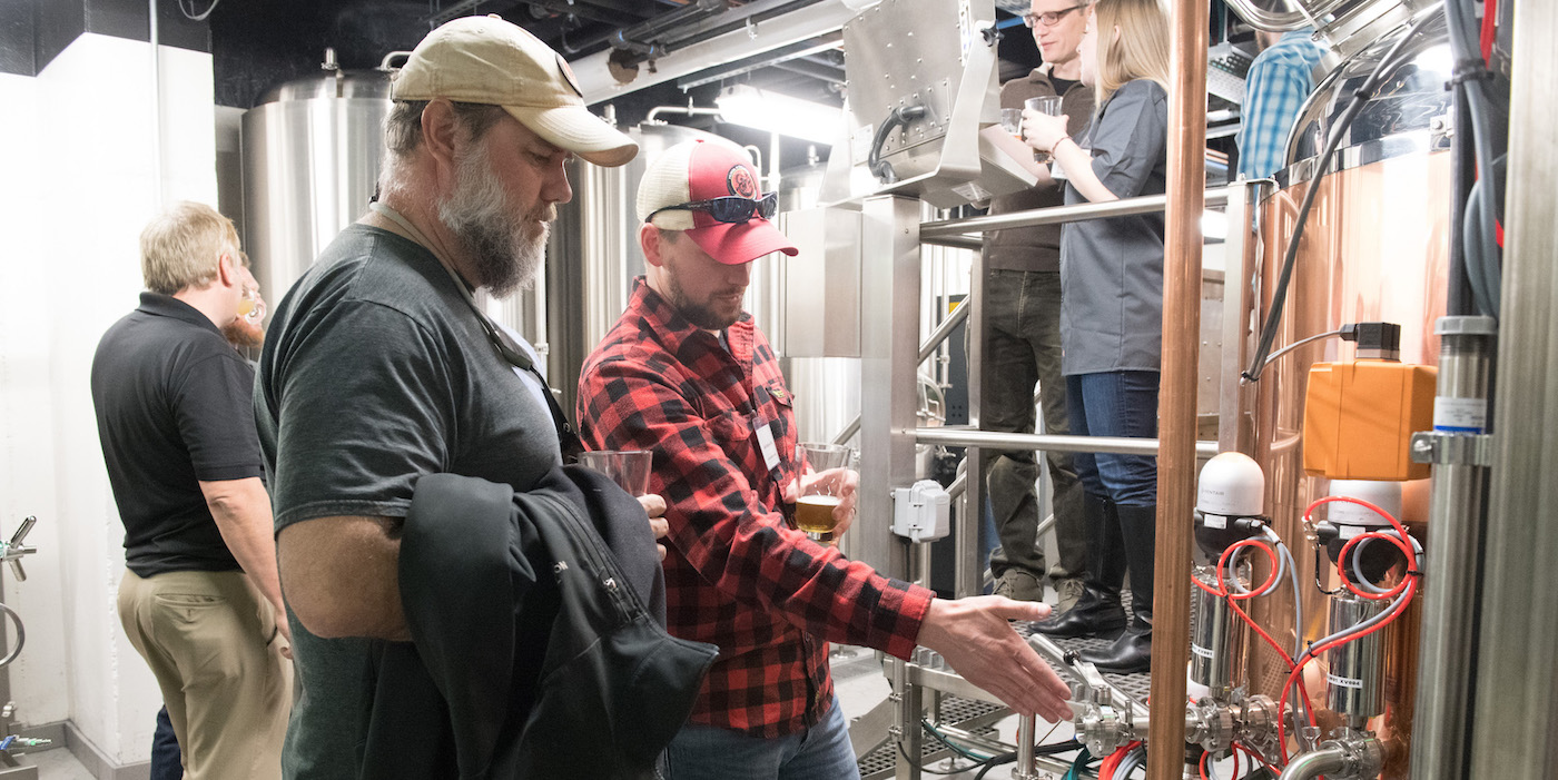 Visitors inspect new brewery