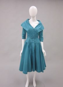 A teal colored, early 1950s dress by Christian Dior.
