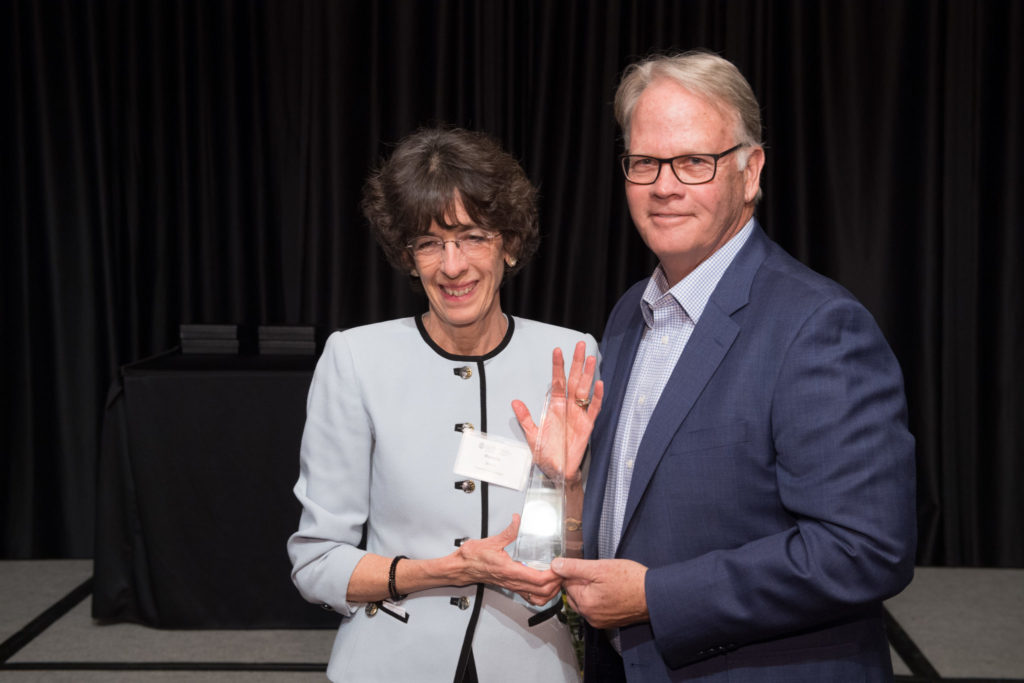 Marcella Wells receives the Friend of the College Award from Jeff McCubbin, Dean of the College of Health and Human Sciences