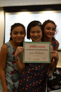 Three girls pose with their certificates of completion from Fashion FUNdamentals 2018.