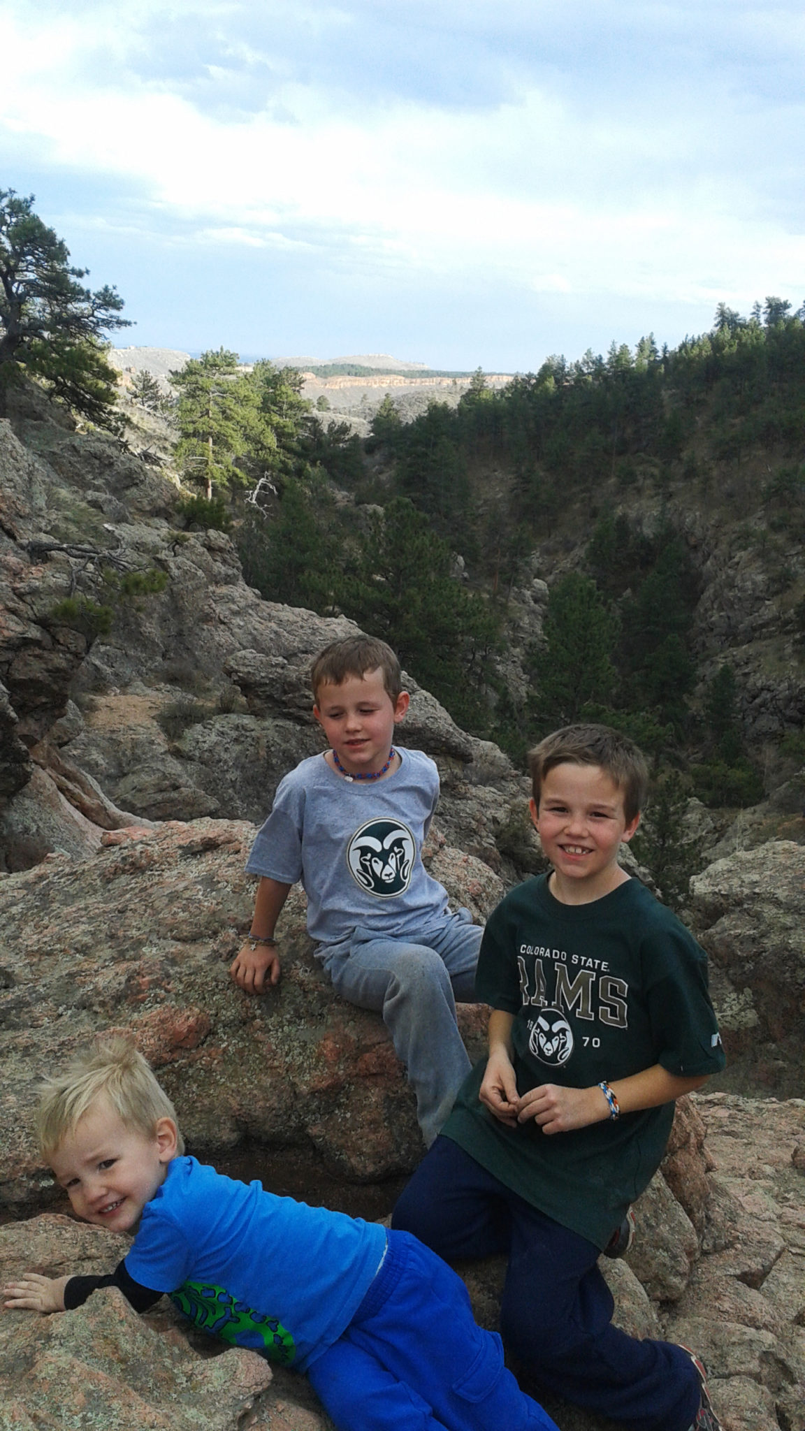 Three young sons of James Graham sitting on rocks