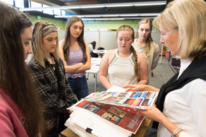 Colorado State University Design and Merchandising professor Stephanie Clemons describes a project to students.