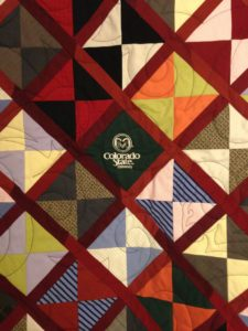 A quilt featuring a CSU square in the center.