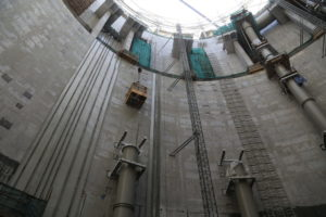 An enormous hole stretches into the earth. This shot, taken from inside teh pump shaft, shows the depth pf the project.