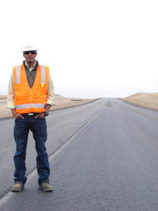 Sandeep stands on a highway that runs near Yellowstone.