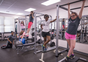 Students from Riverside Elementary School in Pendleton, S.C., participate in a SmartFit Girls session in the school's weight room, April 6, 2017. (Photo by Ken Scar)