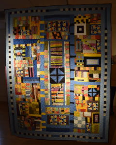 Jeff Millers crazy quilt that adds together nurmerous fabrics from other projects.