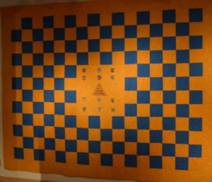 An orange and blue quilt made from the Miller family tent.