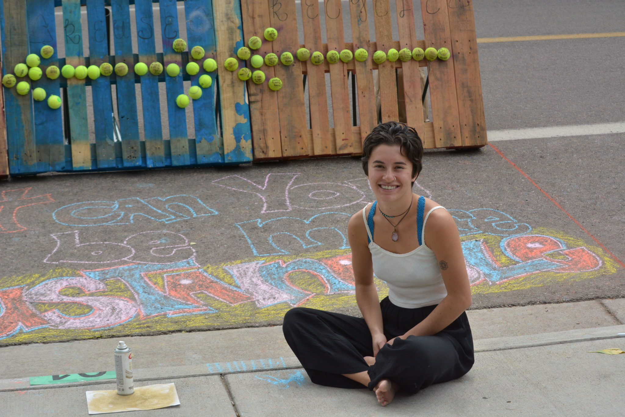 Student sitting with chalk mural