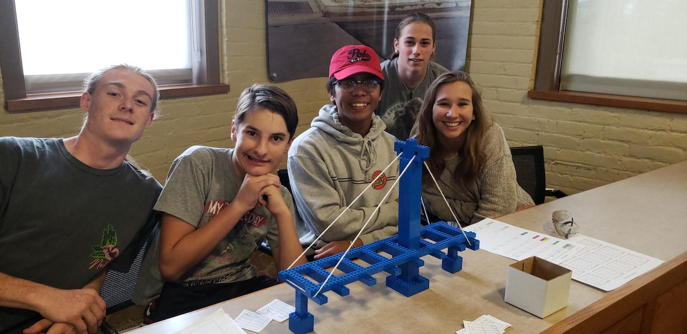 High schoolers with bridge replica