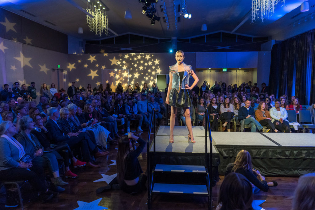 A garment pausing on to show the audience on the runway