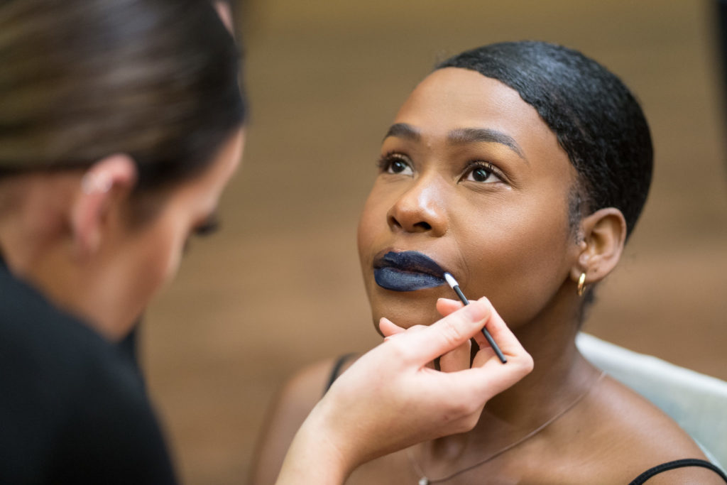 Make up being applied for Sustainable fashion show