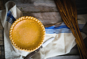 Pie, left, On Rustic Background