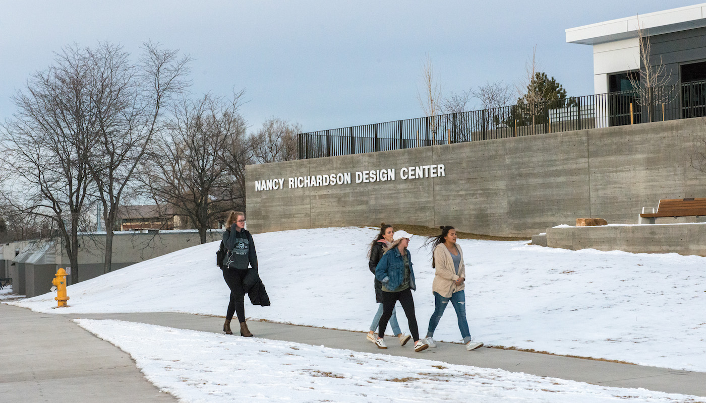 Students walking outside building