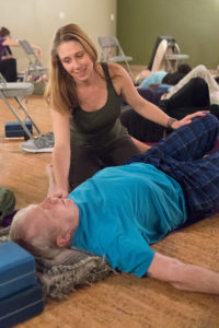 Arlene Schmid helps a participant