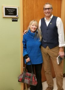 Jane Sullivan stands with HES Department Head Dr. Barry Braun next to microscope room.