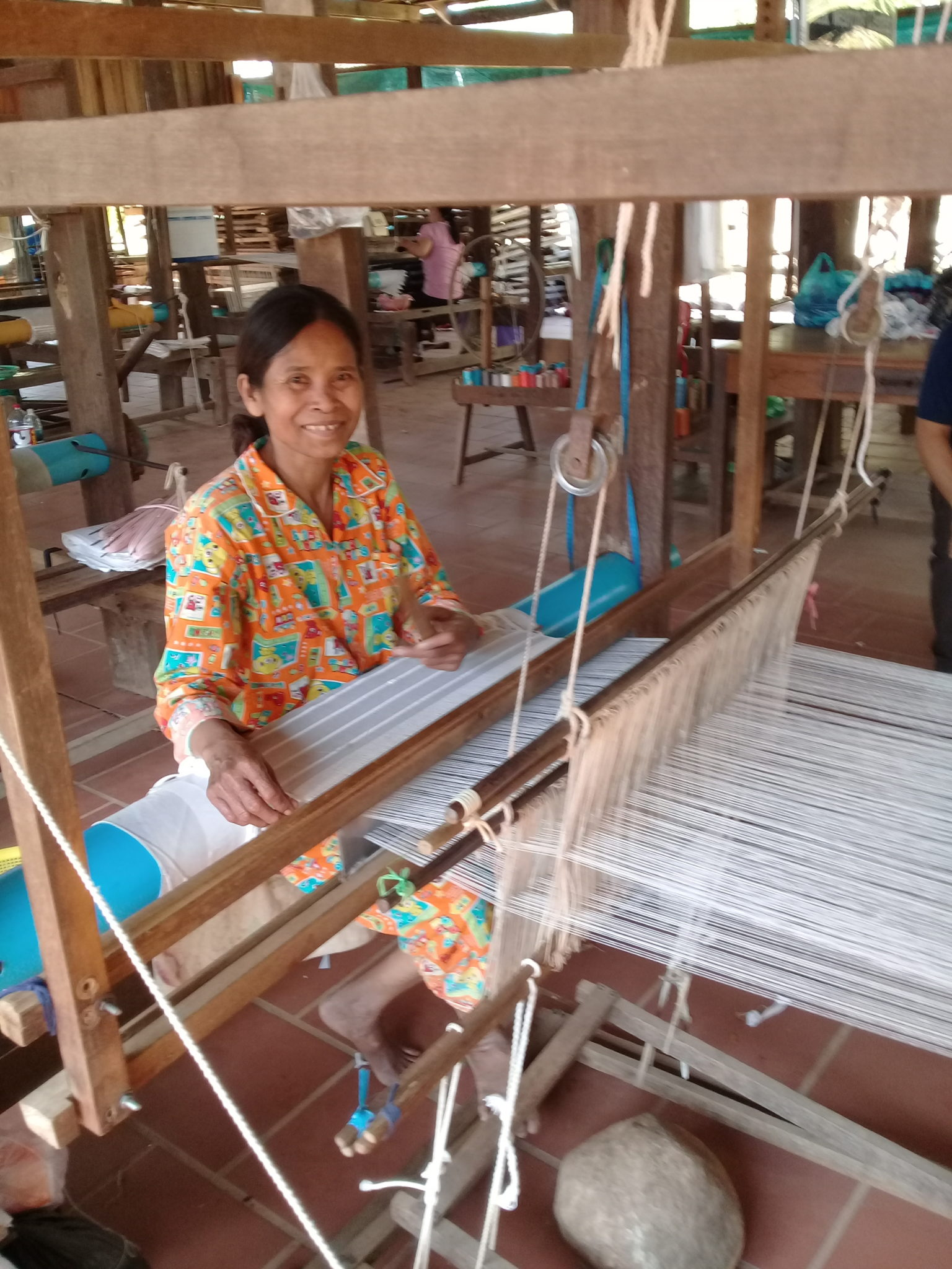 A Cambodian woman working on creating new fabrics