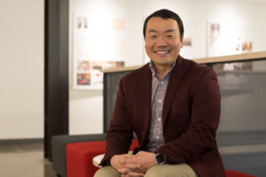 Assistant Professor Dae Seok Chai sits on a chair in the Nancy Richardson Design Center at Colorado State University