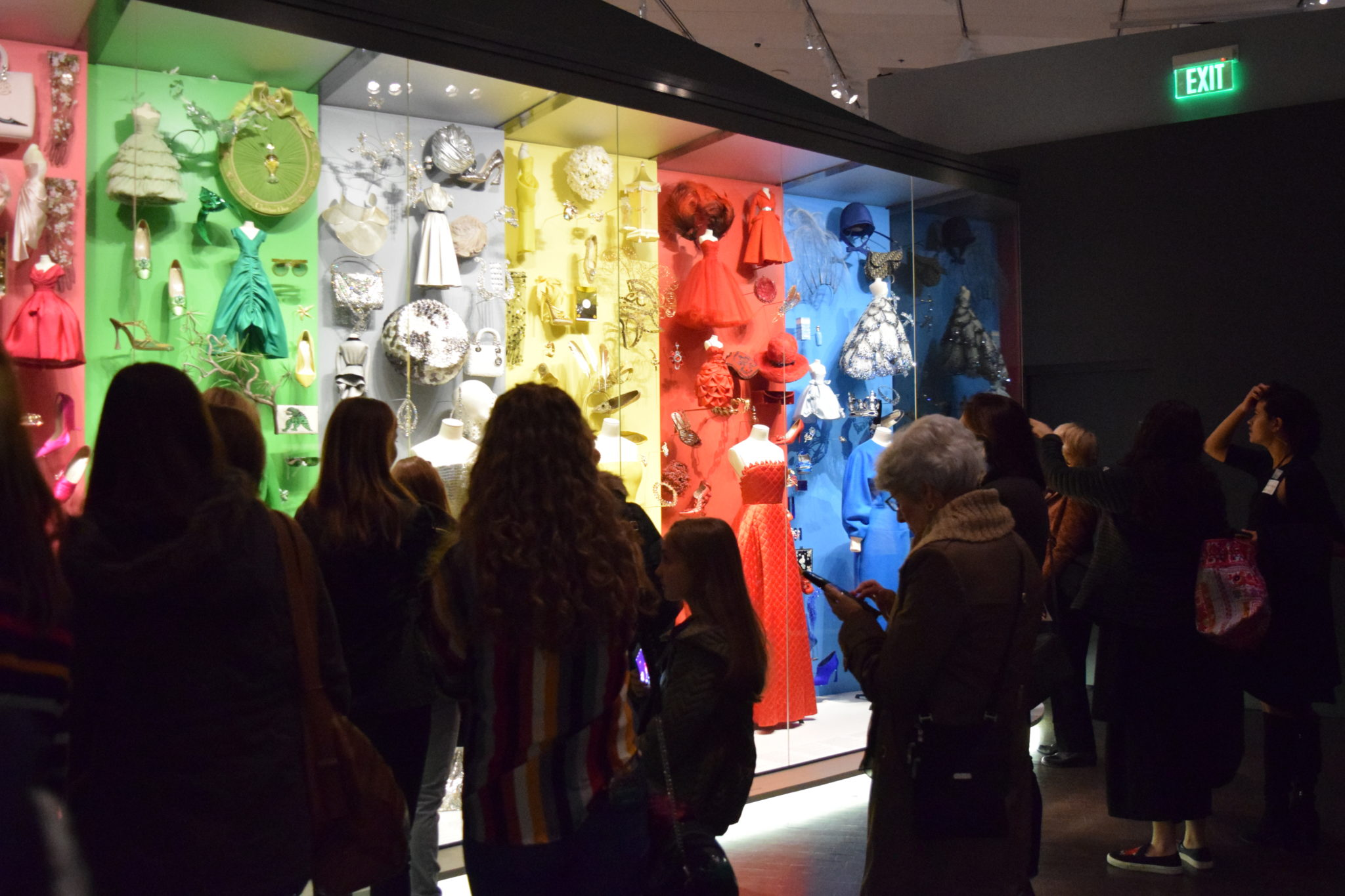 A rainbow display attracts the attention of numerous museum guests.