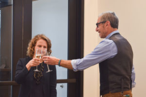 Josiane Broussard (left) toasts with Barry Braun, head of the Department of Health and Exercise Science (right), to mark the grand opening of the SAM facility on Feb. 19.
