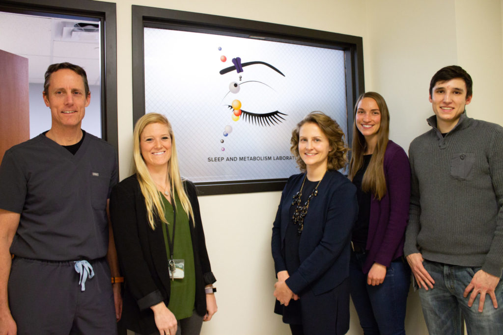 Dr. Josiane Broussard stands with her student investigators in front of the new Sleep and Metabolism (SAM) Laboratory during their grand opening of the facility on February 19th, 2019.