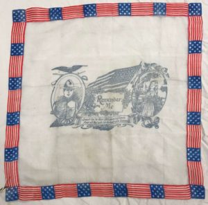 The Miller Handkerchief, with a border made from American flags and a few figures depicted in gray at the center.