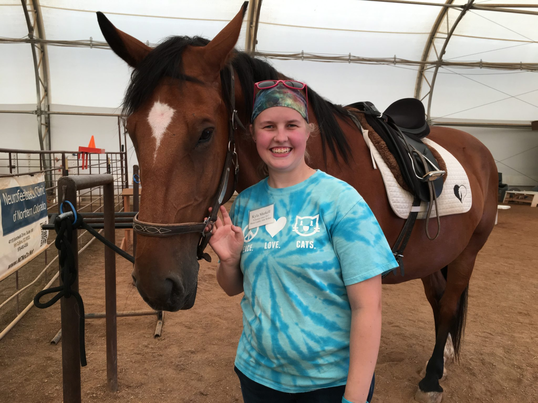 Kyla holding the reins of her horse