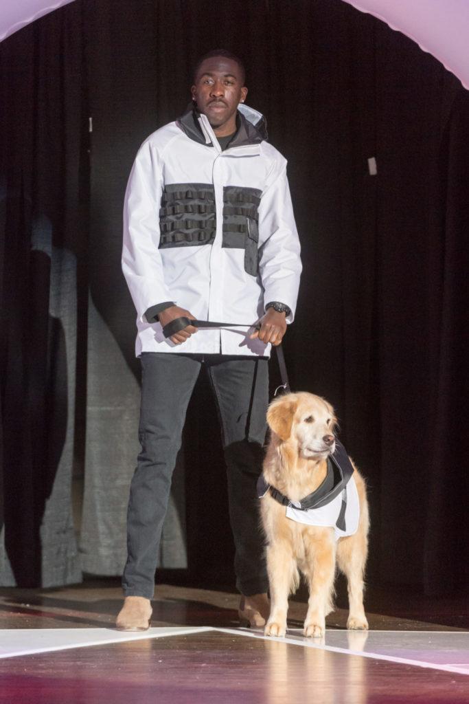 Male model and dog wear matching white jackets.