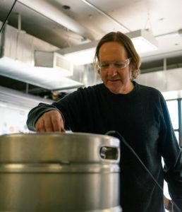 Jeff Biegert with a keg