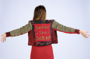 "The back of a jacket that reads ""Seize the scrap"""