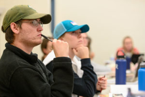Counseling masters students listen in class